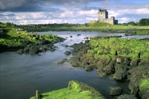 Ireland, Galway, Dunguaire Castle,    Nature, landscape, construction, historically, castle tower castle 16. Jh., buildings, architecture, coast, coast landscape, sea, water, wideness, clouded sky, sight,